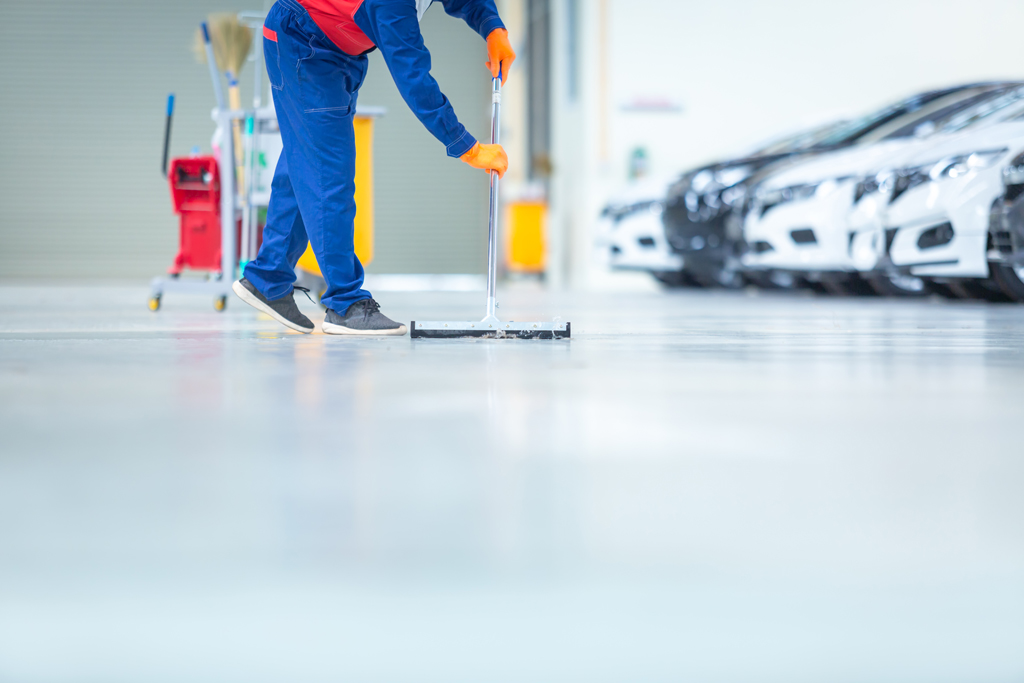 Car mechanic repair service center cleaning using mops to roll w